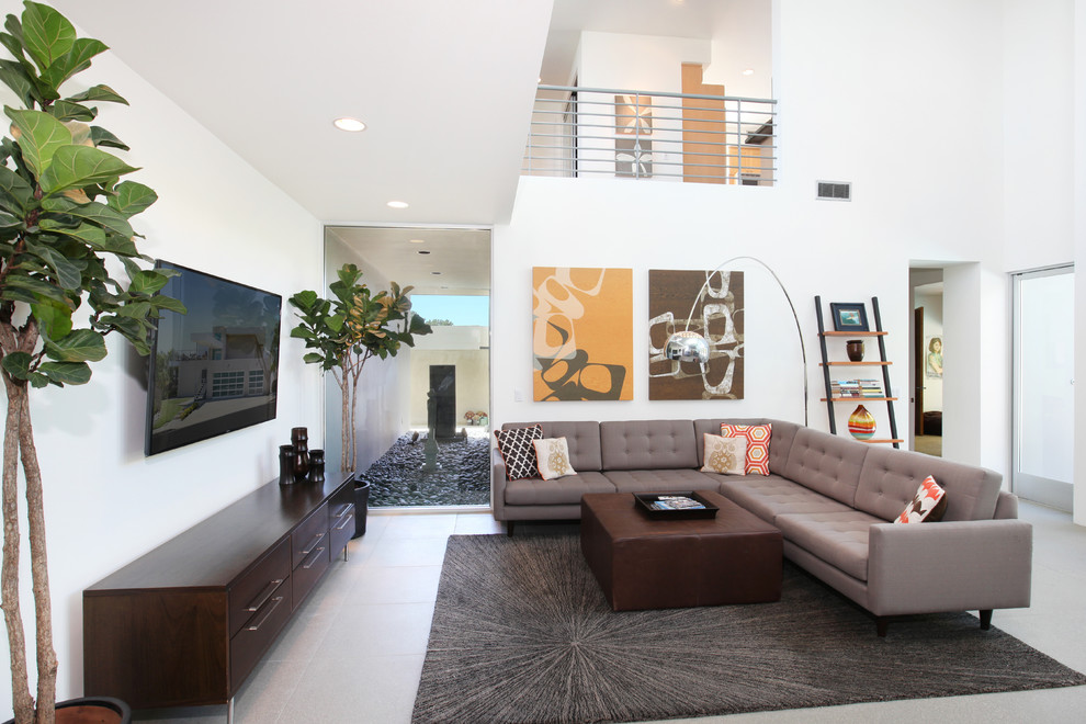 Leaning Bookshelf Living Room Tropical with Accent Pillows Area Rug Balcony Colorful Large Art Gray Upholstery Great Room