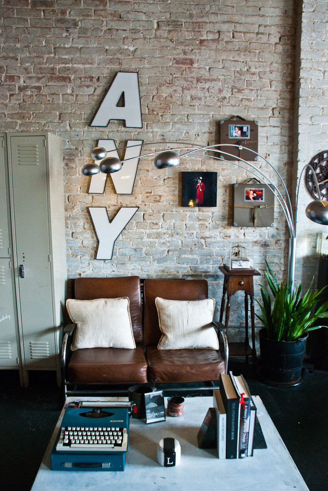 Leather Loveseat Living Room Eclectic with Branching Floor Lamp Brown Leather Loveseat Cream Pillows Exposed Brick Lockers Modern