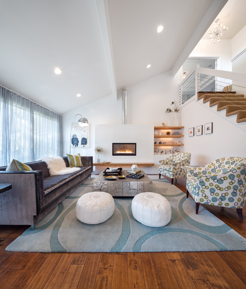 Leather Pouf Living Room Contemporary with Arc Floor Lamp Armchair Built in Shelves Cable Stair Railing Fireplace Floating Shelves