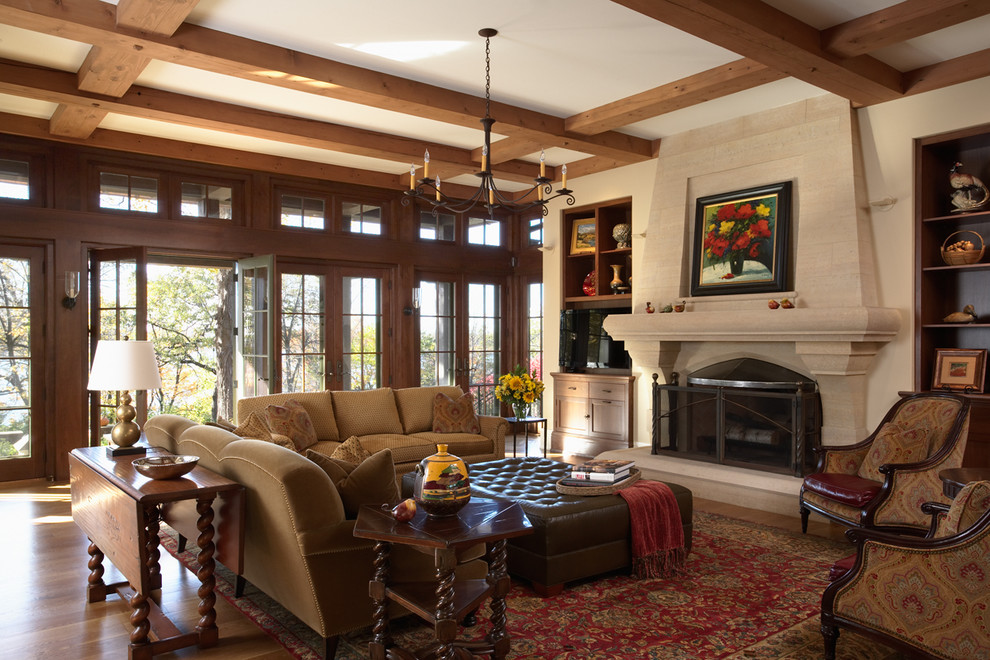 Leather Tufted Ottoman Living Room Traditional with Built in Bookshelves Carved Stone Fireplace Dark Stained Wood French Doors French