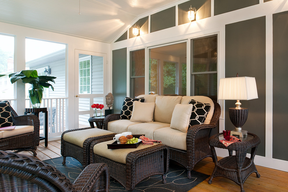 leick furniture Porch Eclectic with area rug ceiling fan geometric pillows railing rocking chairs sun room table