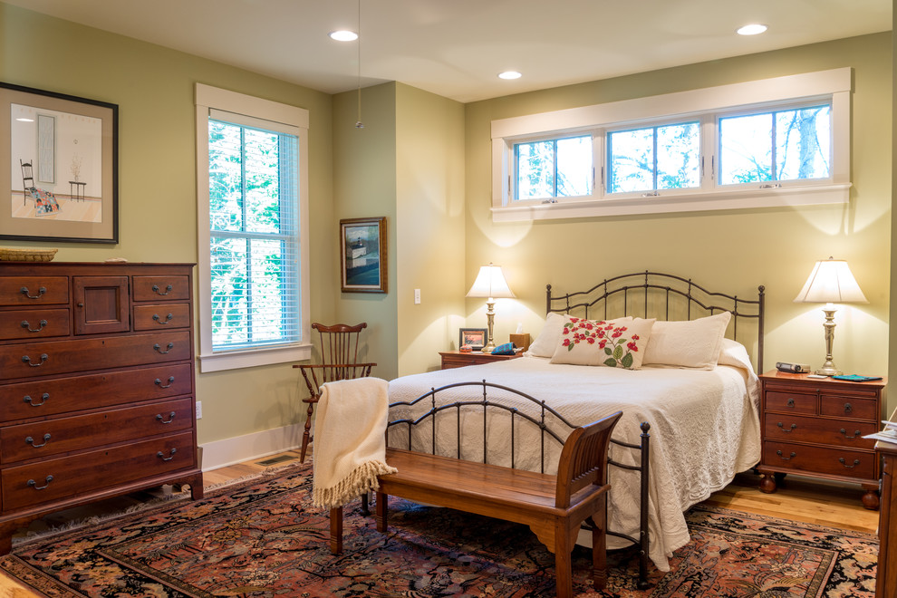 Lexington Furniture Company Bedroom Farmhouse with Antique Bliinds Dark Stained Wood Dresser Iron Bed Light Green Walls Matelass