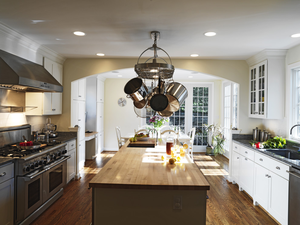 lighted pot rack Kitchen Traditional with butcher block countertops ceiling lighting crown molding eat in kitchen hanging pot