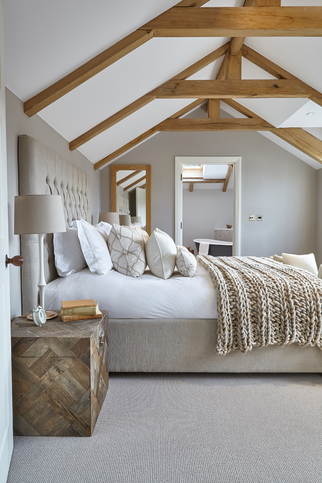 Linen Headboard Bedroom Farmhouse with Beams Bedding Beds Cable Knit Throw Blanket Ensuite Ensuite Bathroom Exposed Beams