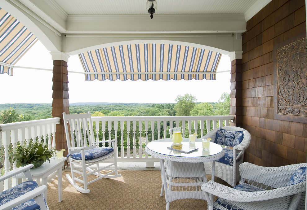 Lloyd Flanders Porch Traditional with Awning Blue Lemonade Porch Railing Rockers Shingle Spindle View White Wicker Yellow