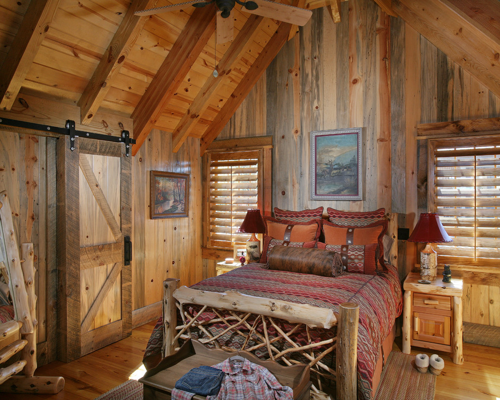 lodge bedding Bedroom Rustic with attic barn door bed pillows bedside table cabin exposed beams lodge nightstand
