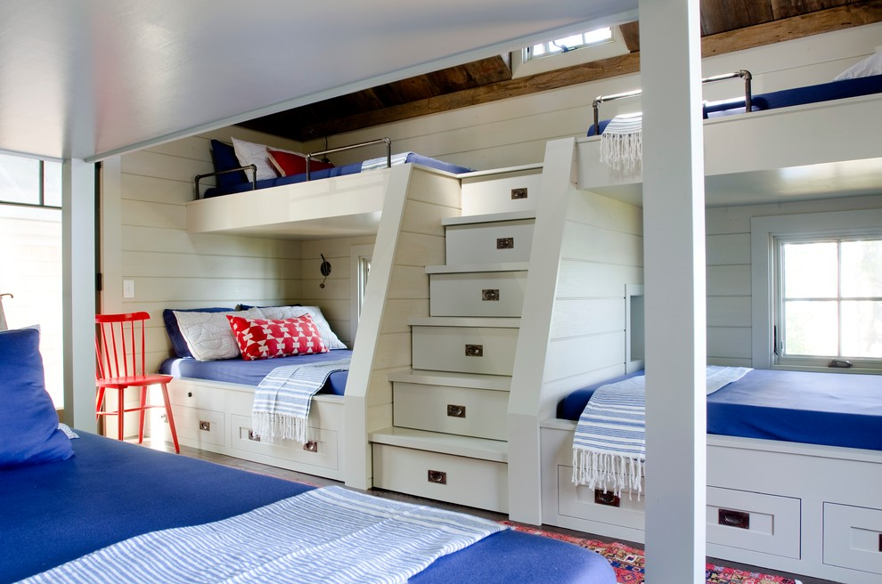Loft Bunk Bed Kids Beach with Blue Bedding Bronze Hardware Bunk Beds Exposed Beams Orange Chair Rustic Ceiling