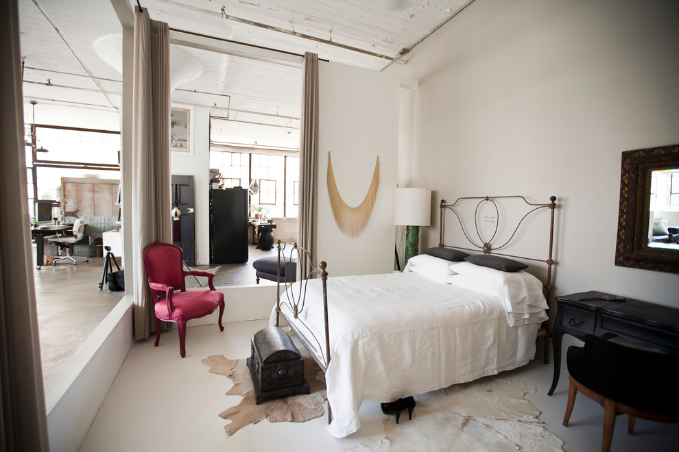 Loloi Rugs Bedroom Industrial with Animal Rug Beige Curtains Concrete Floor Exposed Pipes Iron Bed Loft Loft