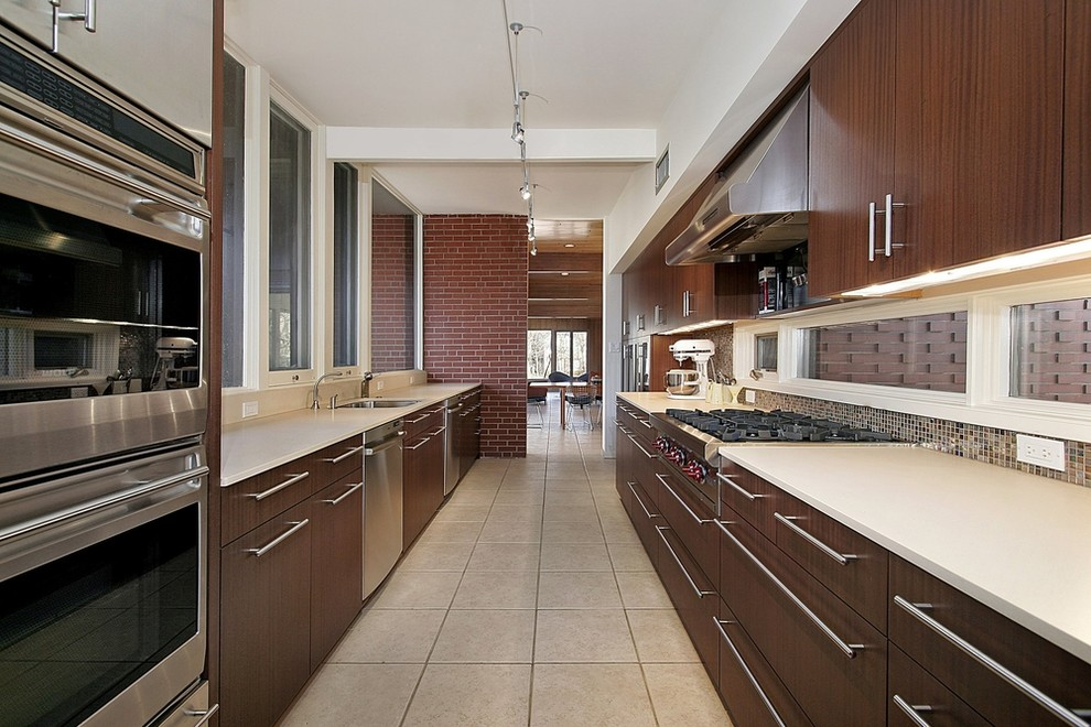 Lucite Chairs Kitchen Contemporary with Backsplash Contemporary Style Countertops Custom Cabinets Granite Countertops Hanging Light Fixtures Hardwood