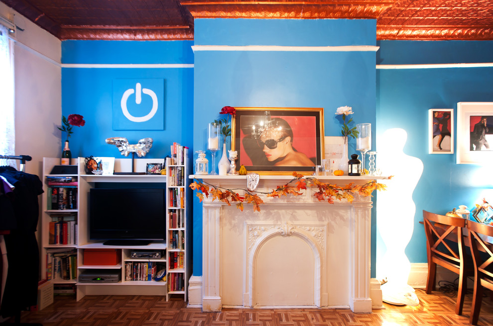 Mantel Clock Living Room Eclectic with Accent Ceiling Artwork Blue Bookshelves Bright Colors Fireplace Floor Lamp Leaf Swag