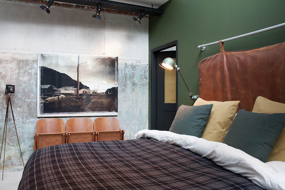 masculine bedding Bedroom Industrial with bachelor pad black track lights concrete wall converted garage doorway green wall