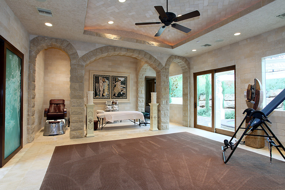 Massaging Chair Home Gym Mediterranean with Alcove Archway Ceiling Fan Columns Double Glass Doors Exercise Equipment Herringbone Ceiling