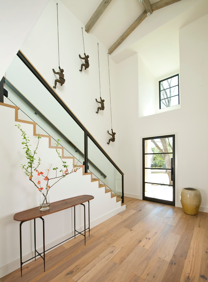 mens apron Entry Contemporary with baseboards clean console table entry exposed beams flowering branches glass railings high