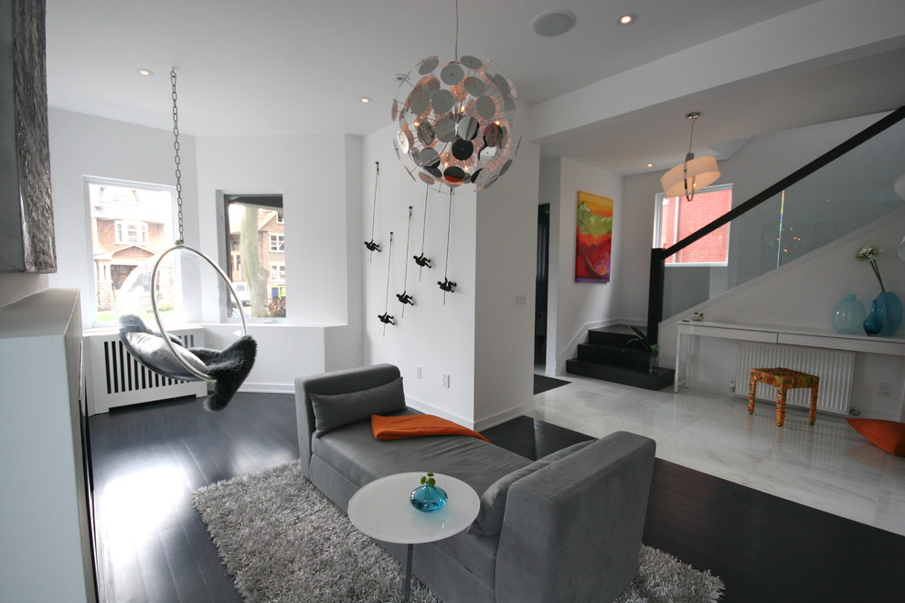 Mens Apron Living Room Modern with Bubble Chair Chrome Chandelier Colorful Stool Dark Floors Foyer Glass Staircase Gray