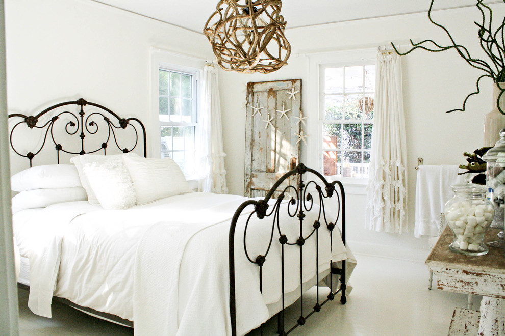 metal headboard Bedroom Shabby chic with beach cottage curtain panels distressed furniture driftwood guest room iron bed neutral