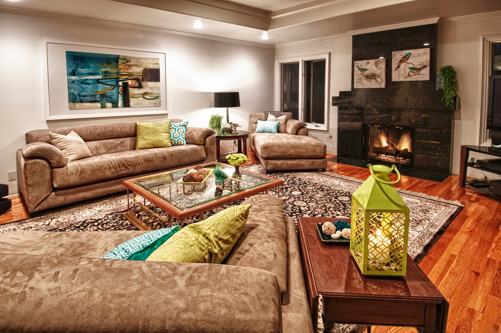 Microfiber Couch Living Room Contemporary with Area Rug Beige Sofa Black Fireplace Candles Chaise Cushions Glass Coffee Table