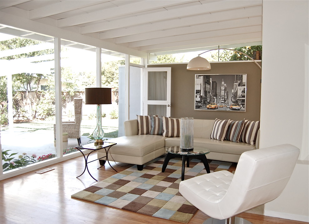 Mid Century Sectional Living Room Contemporary with Arc Lamp Area Rug Black and White Photography Blue Brown Ceiling Beam