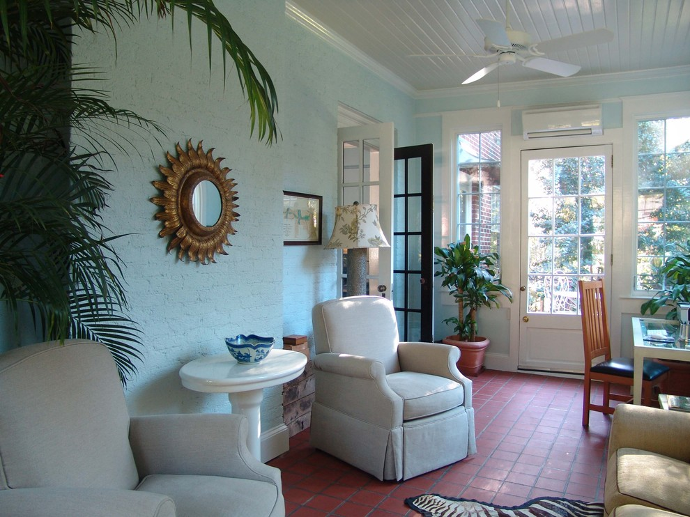 Mini Window Air Conditioner Sunroom Traditional with Exposed Brick French Door Gold Mirror Houseplant Painted Brick Slat Ceiling Sunburst
