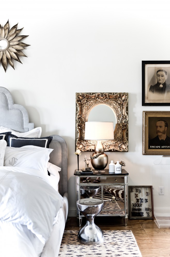 mirrored nightstand Bedroom Transitional with antique photographs bedside table gallery wall leopard print rug mirror mirrored furniture