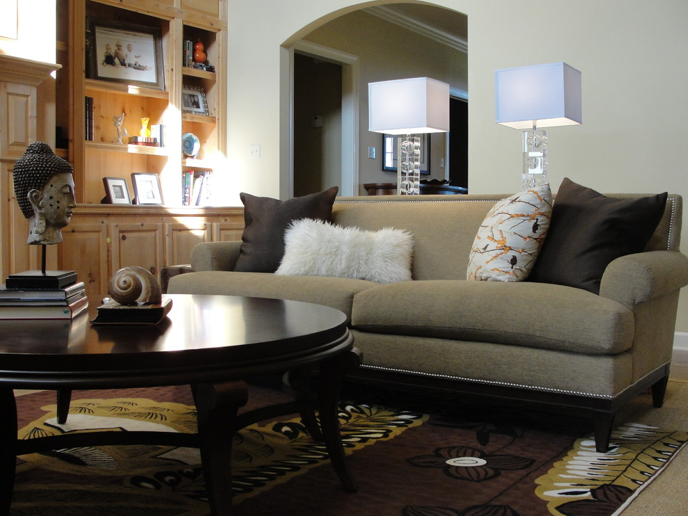Mission Style Sofa Family Room Eclectic with Arched Doorway Area Rug Bookcase Bookshelves Built in Shelves Decorative Pillows Nailhead