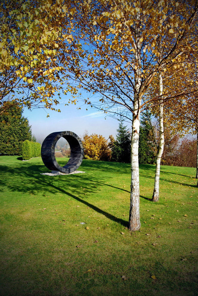 Modern Loveseat Landscape Contemporary with Birch Trees Circle Circular Form Garden Grass Hedge Lawn Sculpture Seating