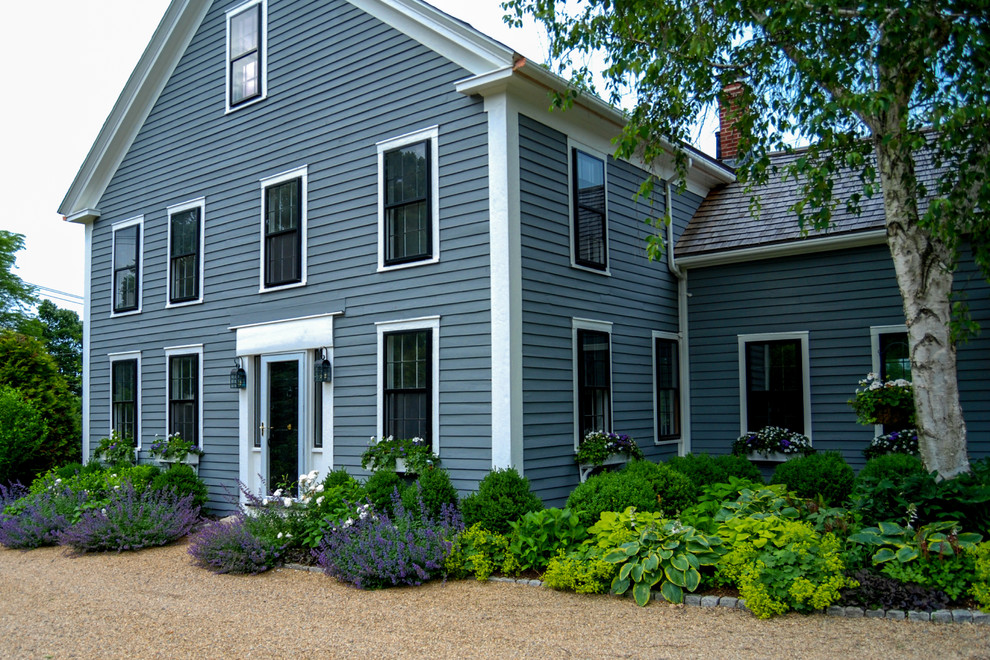 Molly Mutt Landscape Farmhouse with a Blade of Grass Black Window Casings Blue Clapboard Siding Boxwood Classic