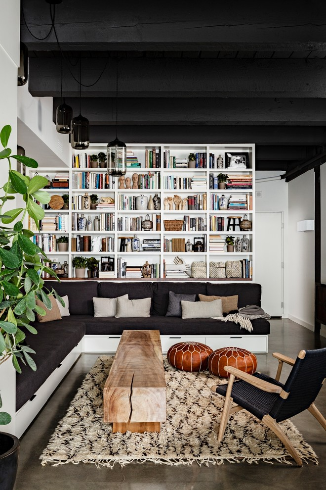 Moroccan Pouf Living Room Industrial with Black Ceiling Black Sofa Black Wood Beam Built in Shelves Chair Corner Sofa