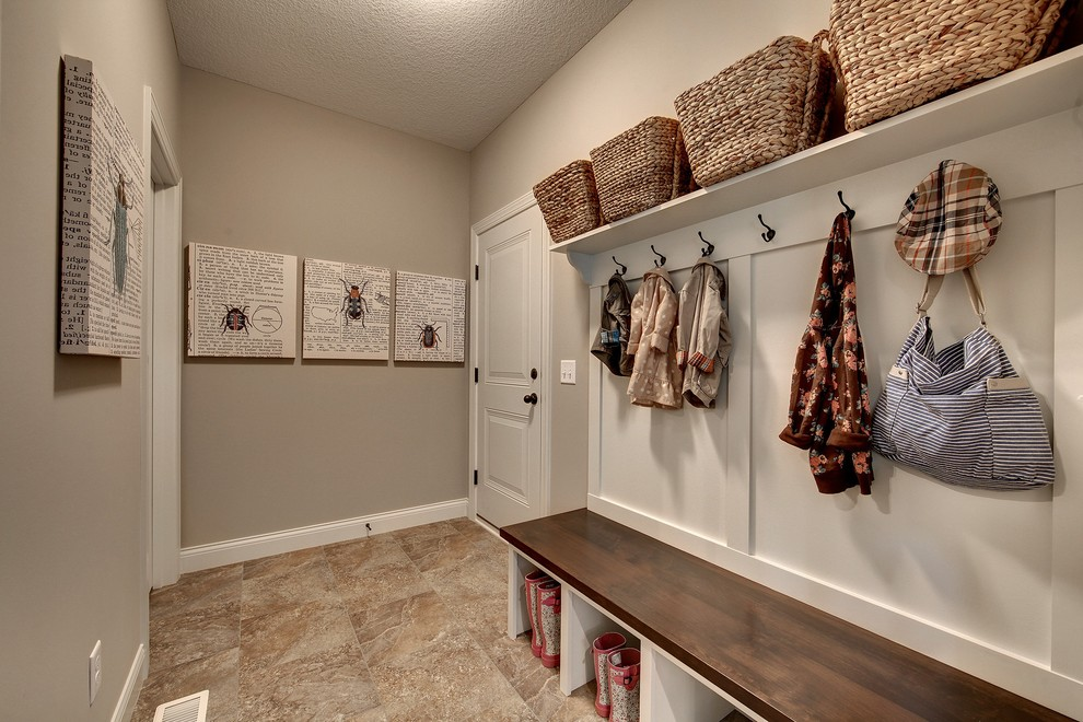 mudroom bench Entry Traditional with artwork boot storage built-in bench coat hooks custom home construction custom home