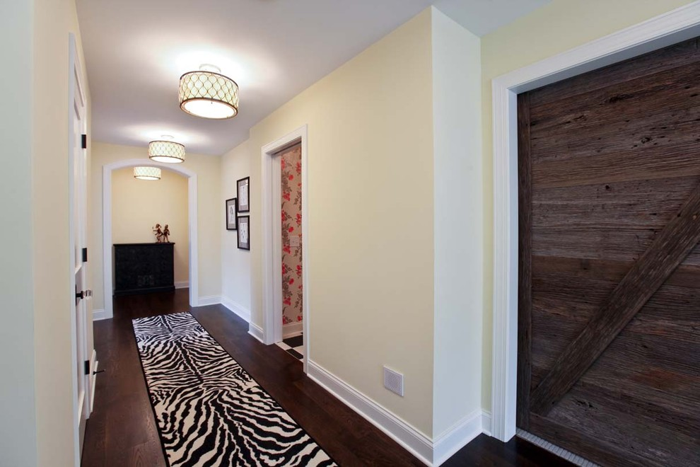 murray feiss Hall Traditional with arch doorway baseboards ceiling lighting dark floor gallery wall hallway reclaimed wood