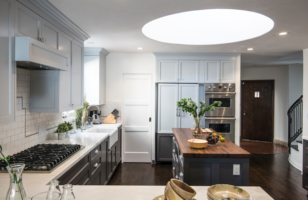 Murray Feiss Kitchen Traditional with Light Blue Cabinets Skylight Subway Tile White Countertop Wood Island Countertop