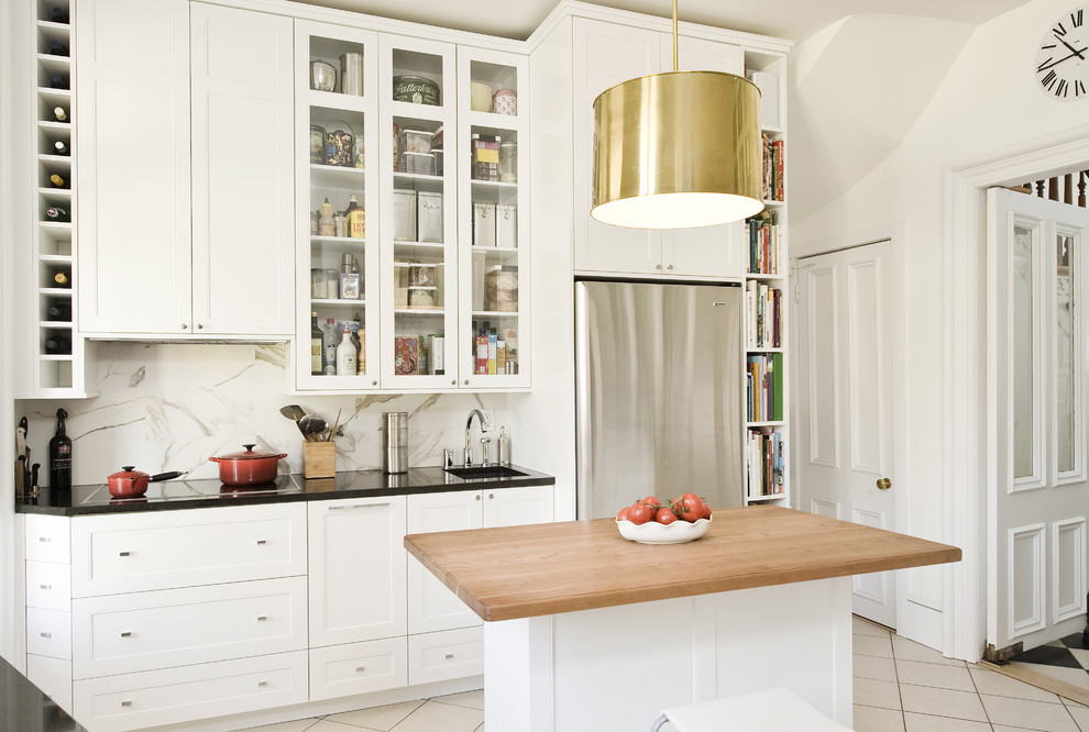 Narrow Bookshelf Kitchen Traditional With Angles Drawers Backsplash Bar Black Countertop Brass Ceilling Light Cabinets