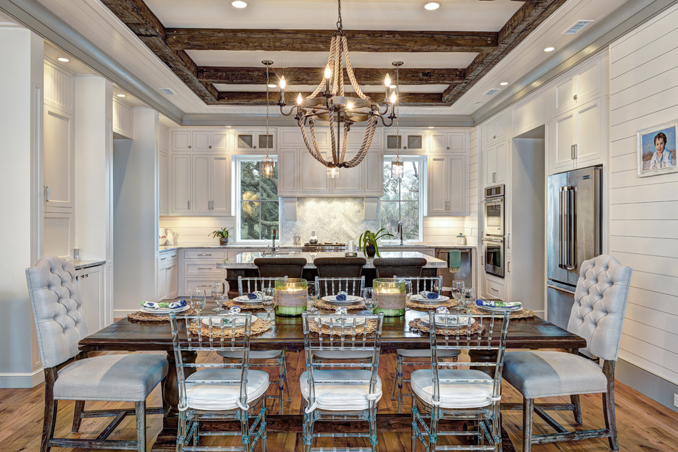 Nautical Chandelier Dining Room Beach with Beamed Ceiling Framed Photos Gray Tufted Chair Great Room Rectangular Dining Table