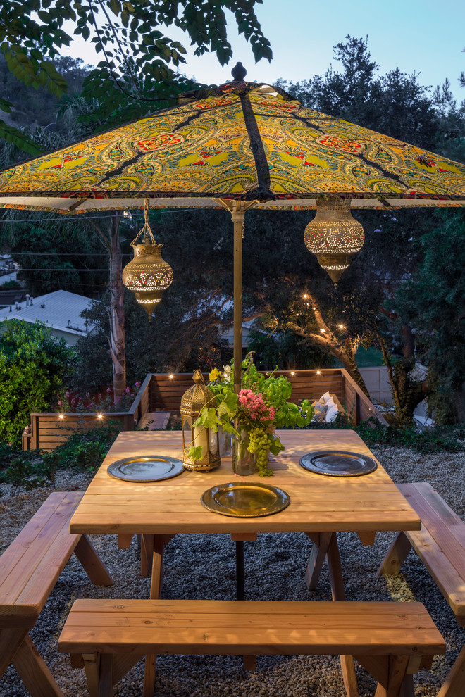 Offset Patio Umbrellas Patio Eclectic with Dining Bench Moroccan Lanterns Outdoor Dining Outdoor Lighting Paisley Umbrella Wood Table