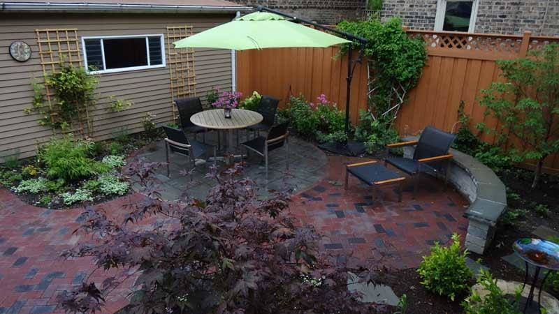 offset patio umbrellas Spaces with bamboo brick pavers chicago city city garden clay pavers green Japanese maple