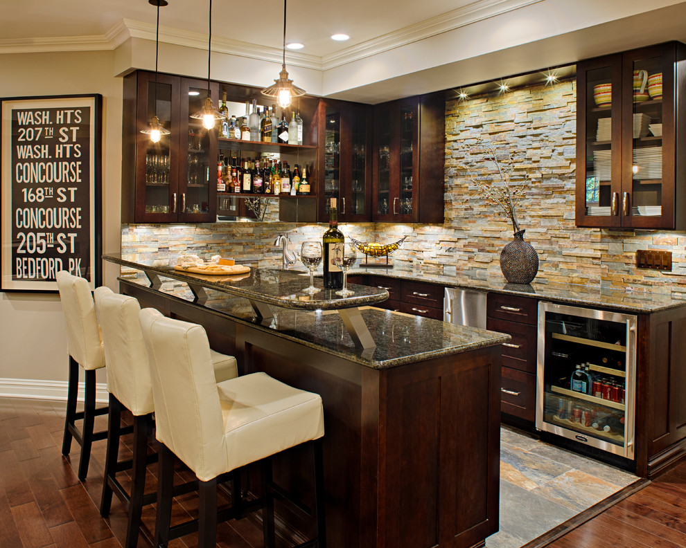 olympic bar weight Home Bar Traditional with dark wood cabinets glass-front cabinets home bar pendant lighting stone backsplash undercabinet