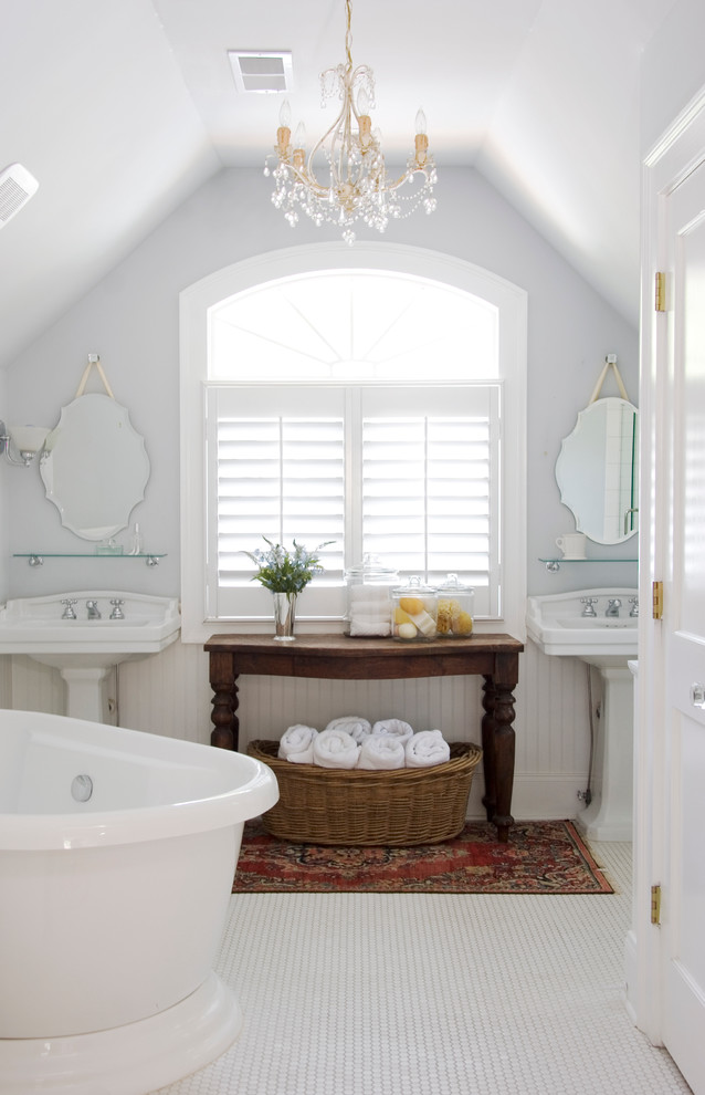 Oriental Rugs Bathroom Traditional with Antique Console Arched Window Freestanding Tub Glass Shelf Glittery Chandelier His and Her Pedestal