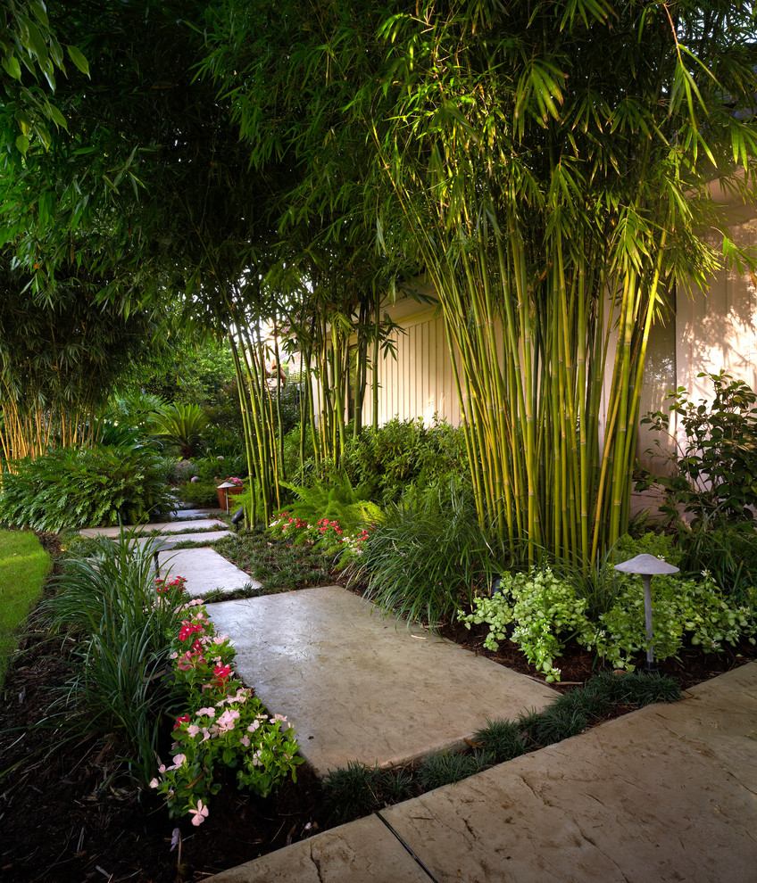Outdoor Bamboo Shades Landscape Tropical with Bamboo Bushes Grass Lawn Path Lighting Pathway Pink Flowers Red Flowers Shrubs