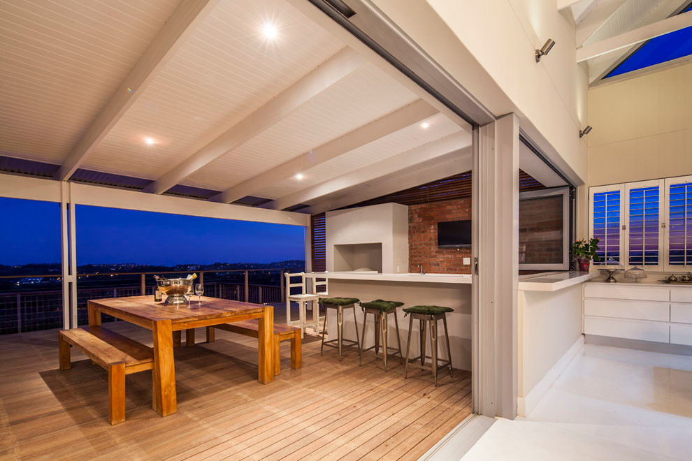 Outdoor Barstools Porch Beach with Bar Area Bar Seating Brick Wall Covered Patio Exposed Beams Green Seat