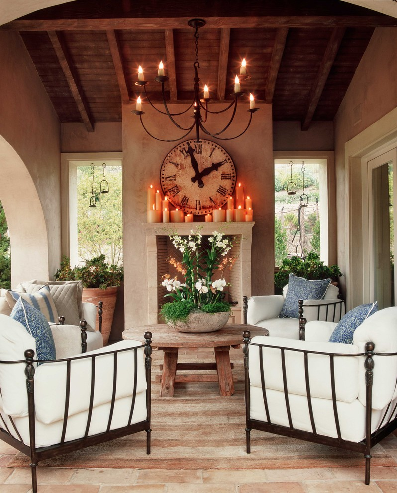 Outdoor Candle Chandelier Patio Shabby Chic with Arched Doorway Brick Brick Floor Covered Patio Fireplace Iron Furniture Rustic Terra Cotta