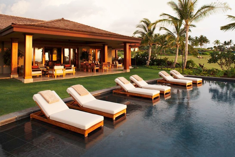 outdoor chaise lounge Pool Tropical with beige outdoor cushions beige patio floor column covered patio grass lawn outdoor