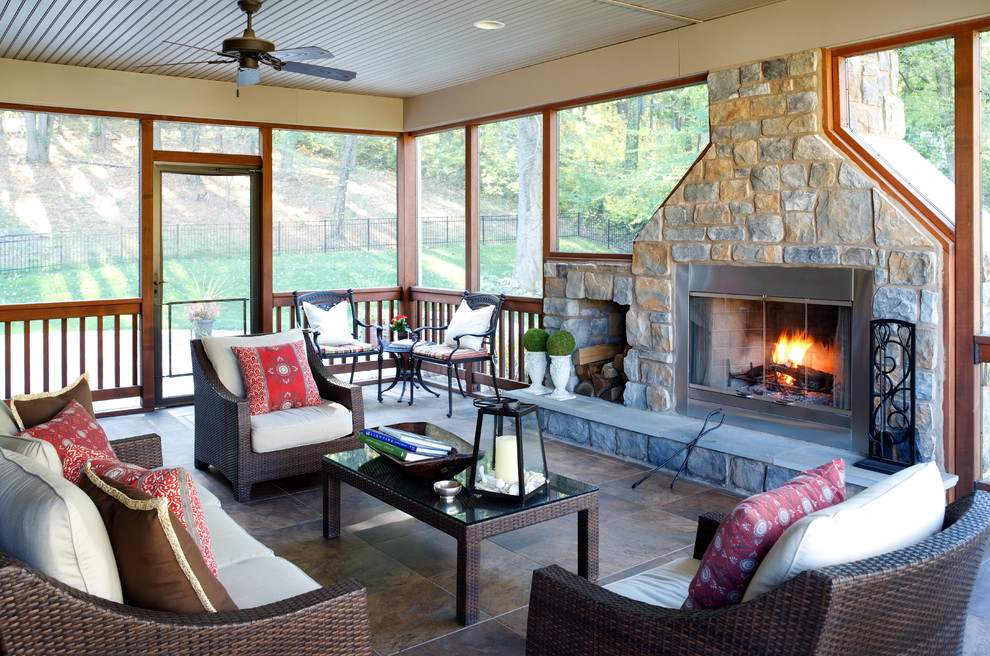 outdoor propane fireplace Porch Rustic with ceiling fan Fireplace four season room french doors log storage organic outdoor