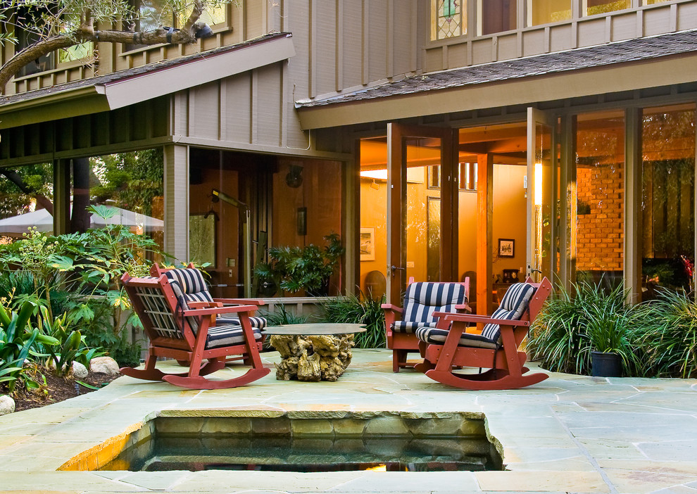 outdoor rockers Patio Traditional with brown exterior brown siding bushes driftwood coffee table home designed by disciple