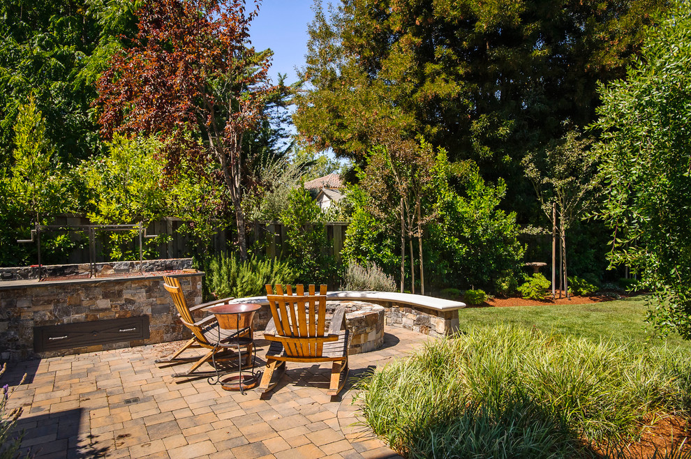 Outdoor Rocking Chair Patio Traditional with Brick Patio Built in Fire Pit Copper Side Table Curved Stone Wall Grass