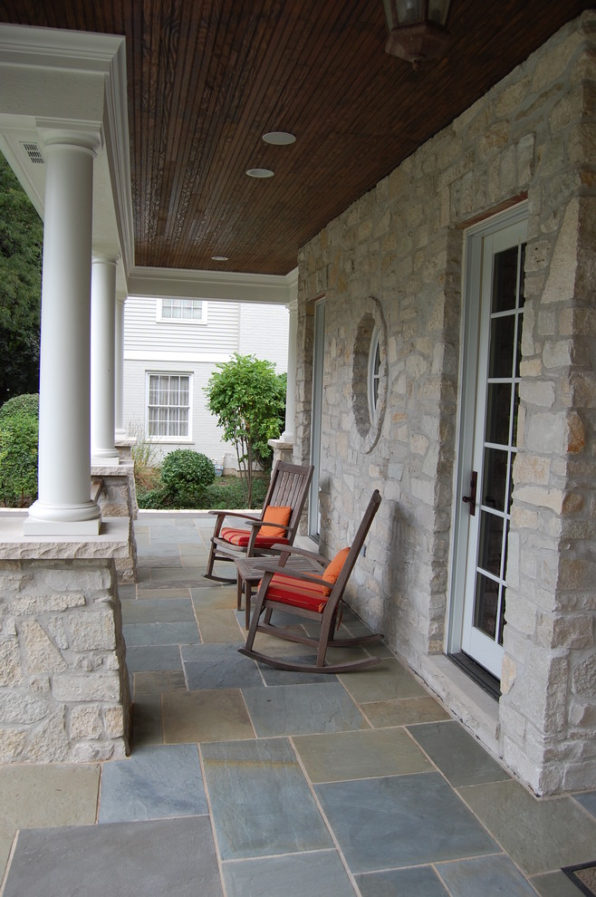 outdoor rocking chairs Porch Traditional with hanging lantern outdoor rocking chairs outdoor table recessed lighting stone column stone