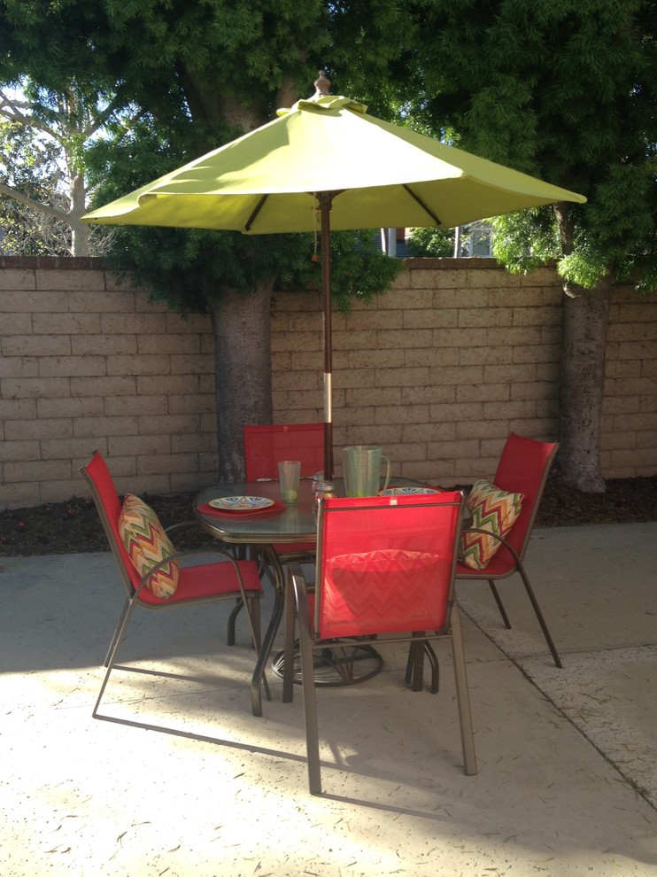 Outdoor Umbrella Stand Patio Transitional with Block Walls Cement Patio Cement Tiles Green Umbrella Landscape Outdoor Dining Outdoor
