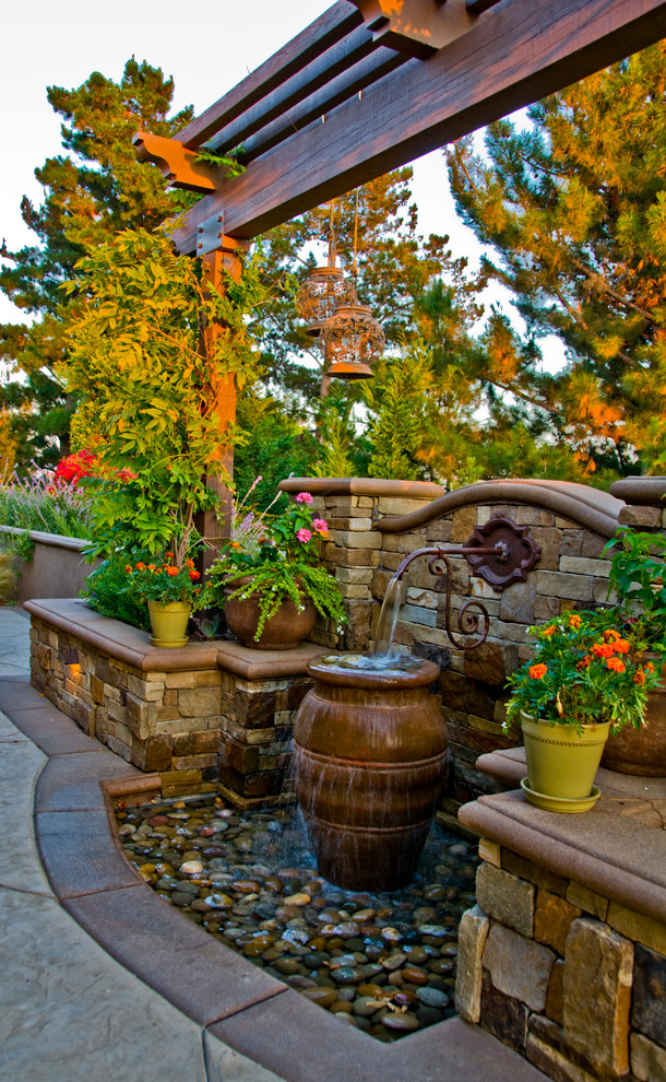 outdoor water fountains Landscape Mediterranean with concrete patio flagstone fountain fountain Emitter Orange Flowers outdoor potted plant outdoor