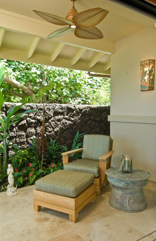 Oversized Chairs Patio Tropical with Border Plantings Candle Holders Candles Ceiling Fan Covered Patio Eaves End Table