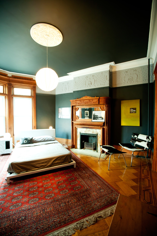 Oversized Rugs Bedroom Contemporary with Area Rug Cowhide Crown Molding Dark Ceiling Dark Walls Fireplace Fireplace Mantel