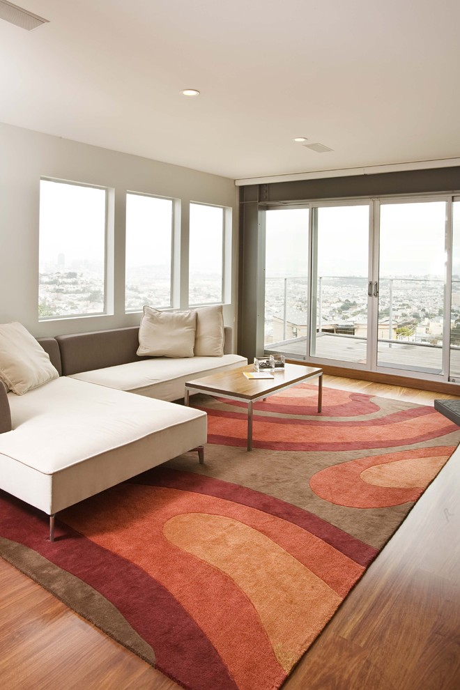 oversized rugs Family Room Contemporary with area rug balcony corner sofa glass doors minimal neutral colors sectional sofa