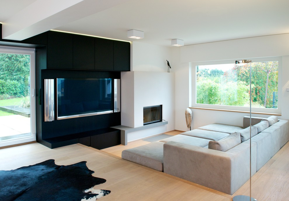 Oversized Sofa Home Theater Modern with Animal Hide Area Rug Black and White Black Media Wall Fireplace Floor